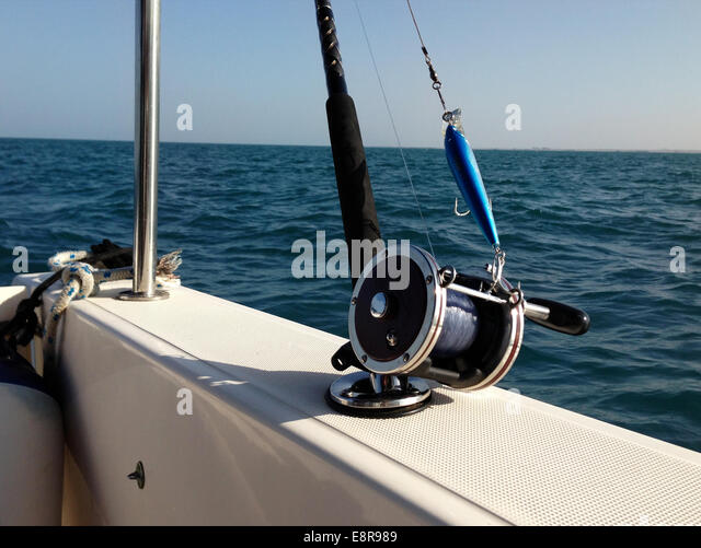 Blue mediterranean trolling boat fishing stock photos for Big game fishing rods
