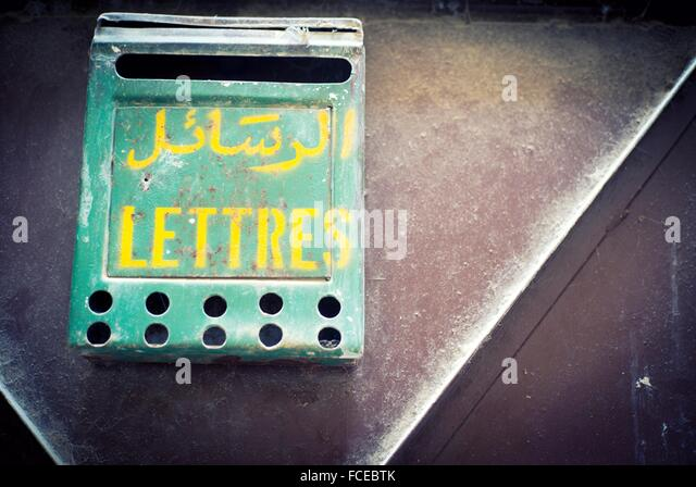 Green Mailbox Hanging On The Door Of A House, With Text In French, Lettres