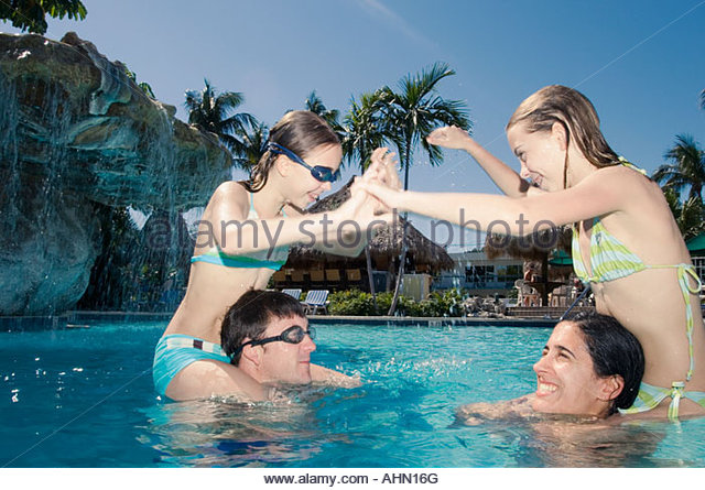 Family water fight stock photos family water fight stock for Chicken in swimming pool
