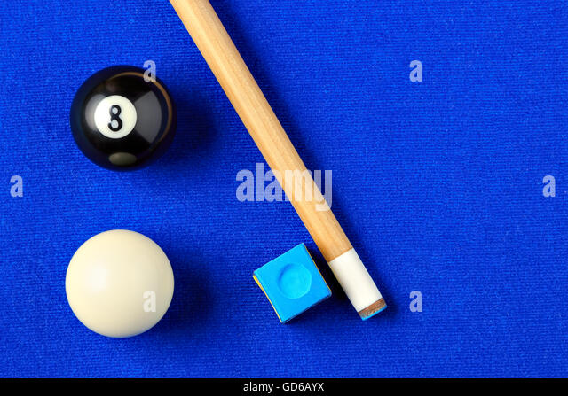 Billiard Balls, Cue And Chalk On A Blue Pool Table. Viewed From Above.