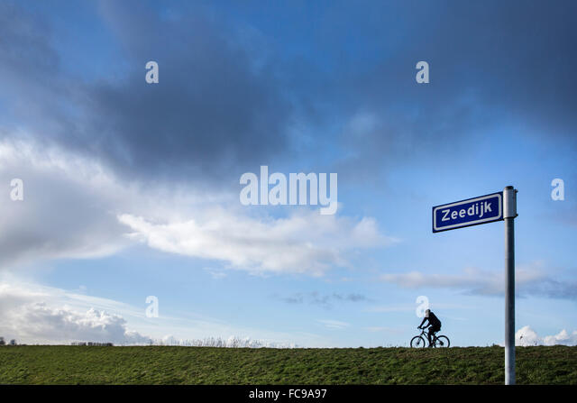 Dutch street name stock photos dutch street name stock images netherlands putten arkemheen polder street sign with name of country road sea sciox Gallery