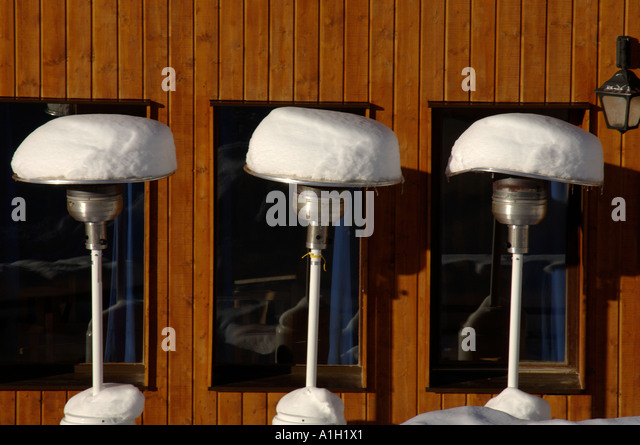 Gas Powered Patio Heaters Covered In Snow Outside A Mountain Restaurant    Stock Image