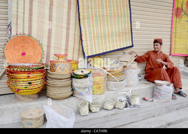 A man sells handmade home decoration items at his roadside stall  to earn  his livelihood. Handmade Home Decoration Items Stock Photos   Handmade Home