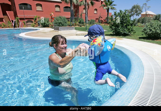 Pregnant Mother Toddler In Pool Stock Photos Pregnant Mother Toddler In Pool Stock Images Alamy