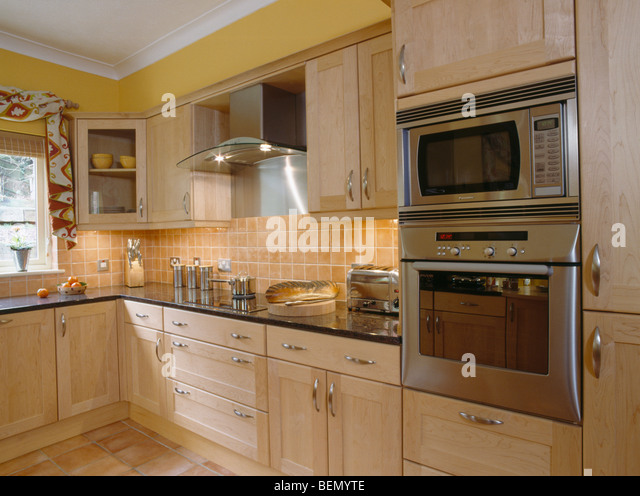 Yellow Microwave Oven ~ Microwaves modern stock photos