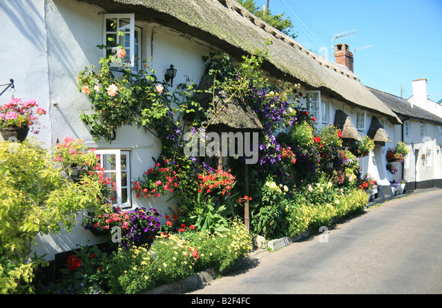 Cute thatched cottage stock photos cute thatched cottage for Beautiful cottages pictures