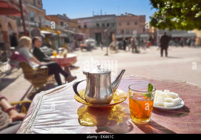 Traditional moroccan green mint tea in glass with tea pot, Morocco ...