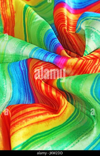 Rainbow fabric flag silk scarf gay symbol. - Stock Image
