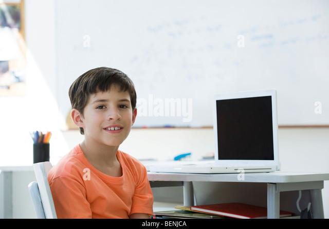 Brilliant Elementary Student Sitting At Desk School Portrait Stock Image In Inspiration Decorating