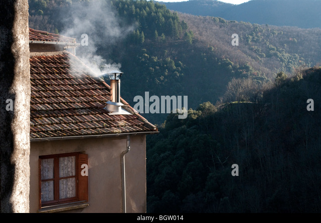 Smoke Coming From Chimney House Stock Photos & Smoke Coming From ...