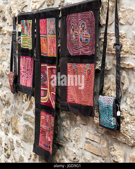 KORNELIMUENSTER, GERMANY, 18th June, 2017 - wall hangings and purses for sale on the historic fair. - Stock Image