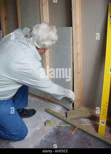 Sound deadening stock photos sound deadening stock images alamy model released do it yourself male age 65 fitting sound deadening insulation in solutioingenieria Image collections