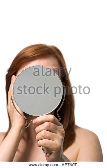 woman holding hand mirror. Mature Woman Holding A Hand Mirror - Stock Image N