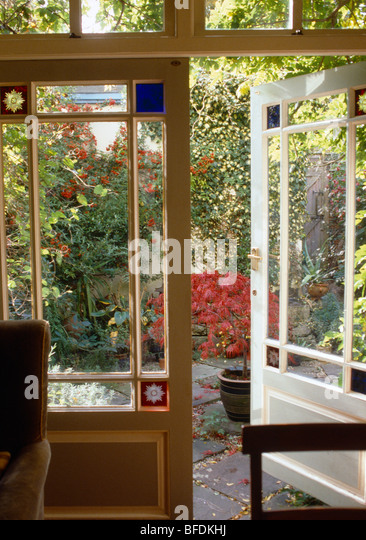 Open Half Glazed French Double Doors With Stained Glass Detail In Dining Room