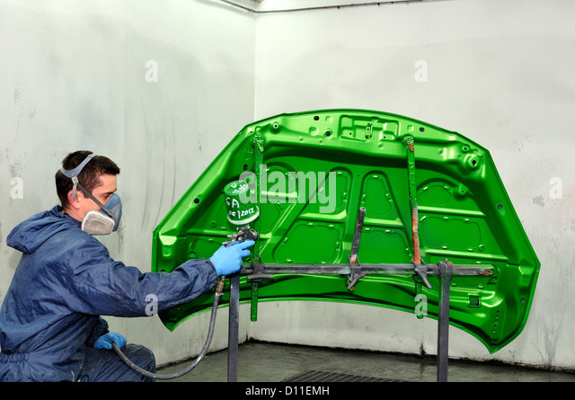 spray painted in spray booth worker painting car parts painting a car. Black Bedroom Furniture Sets. Home Design Ideas