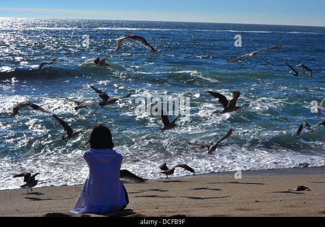 Sad Girl Sitting Beach...