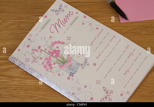Birthday card envelope stock photos birthday card envelope stock birthday card and pink envelope against wooden table background for mum stock image bookmarktalkfo Images
