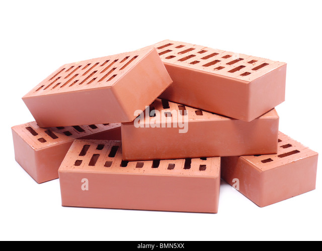 Pile Of Perforated Bricks Over White Background