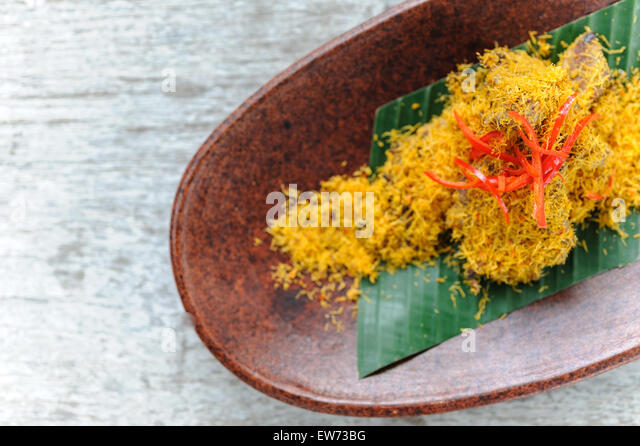 Indonesian Style Beef Rendang Served With Sauteed Coconut And Red Chillies Stock Image
