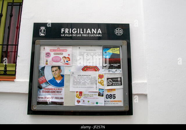 A notice board on the wall of the town council offices in Frigiliana, Andalusia, Spain, Costa del Sol - Stock Image