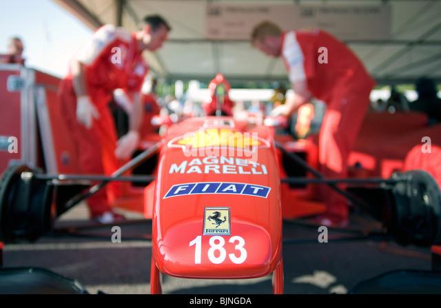 Ferrari Mechanics Working On A Ferrari F1 Car.   Stock Image
