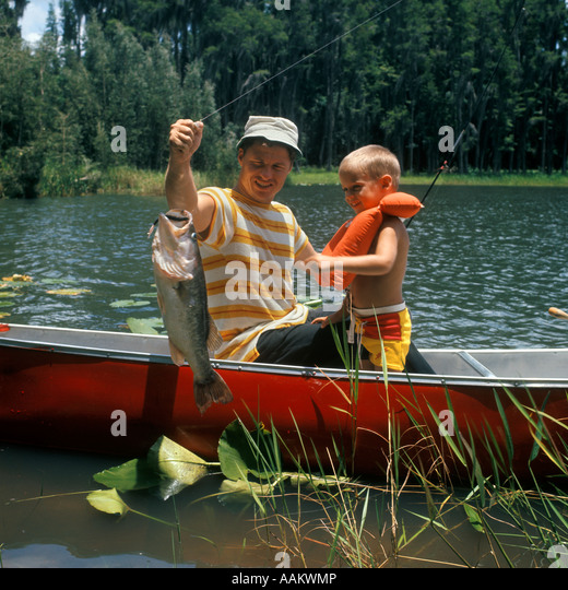 Family 1980s stock photos family 1980s stock images alamy for Father son fishing