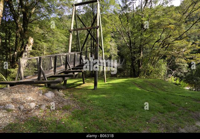 Wooden swing bridge stock photos wooden swing bridge for Wooden swing set with bridge