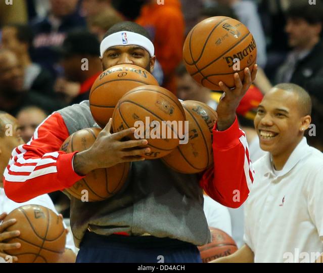 the-atlanta-hawks-josh-smith-draws-a-laugh-as-he-grabs-a-slew-of-basketballs-dd4ach.jpg