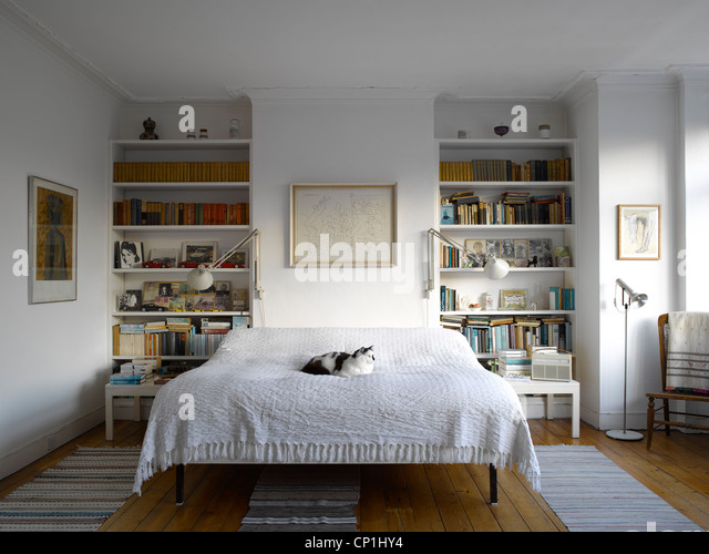 Bedroom with bookcases   Stock Image. Bed Shelving Storage Stock Photos   Bed Shelving Storage Stock