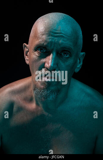 Close-up portrait of an old man. He is a strange and terrible.  Wicked eye and look of a madman. - Stock Image
