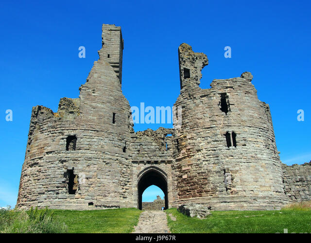 Dunstanborgh castle in northumbria main gateway - Stock Image