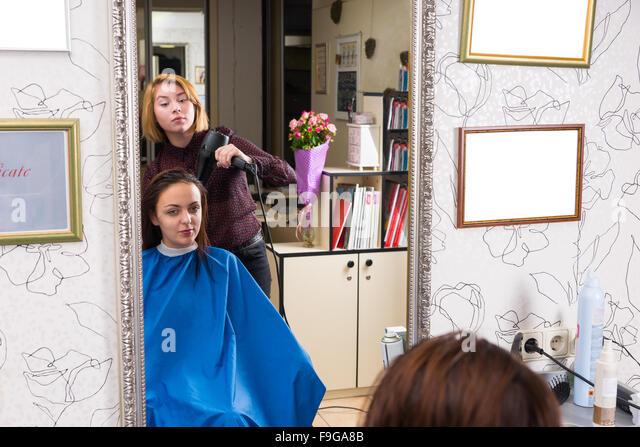 salon color smocks beauty salon professional blow drying stock photos beauty salon