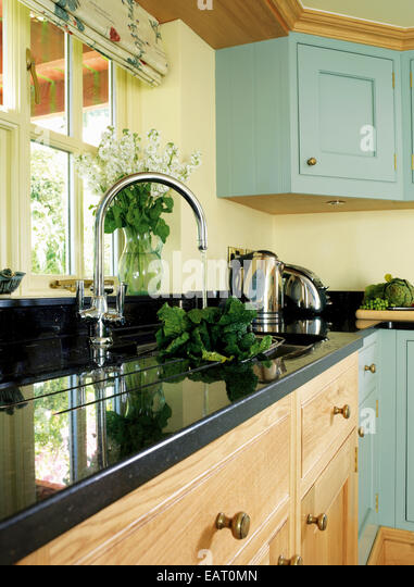 water running from tap fitting into kitchen sink stock image - Kitchen Sink Tap Fittings