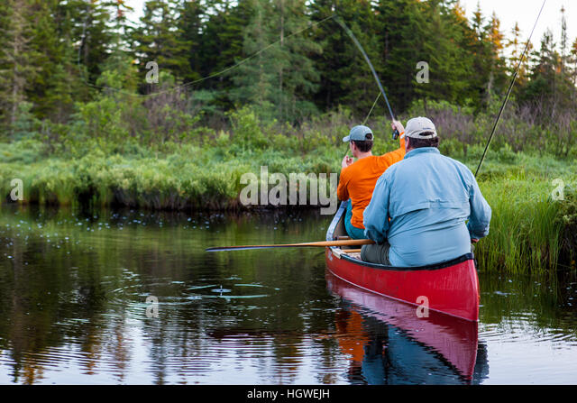 Two men fly fishing brook trout stock photos two men fly for Fly fishing canoe