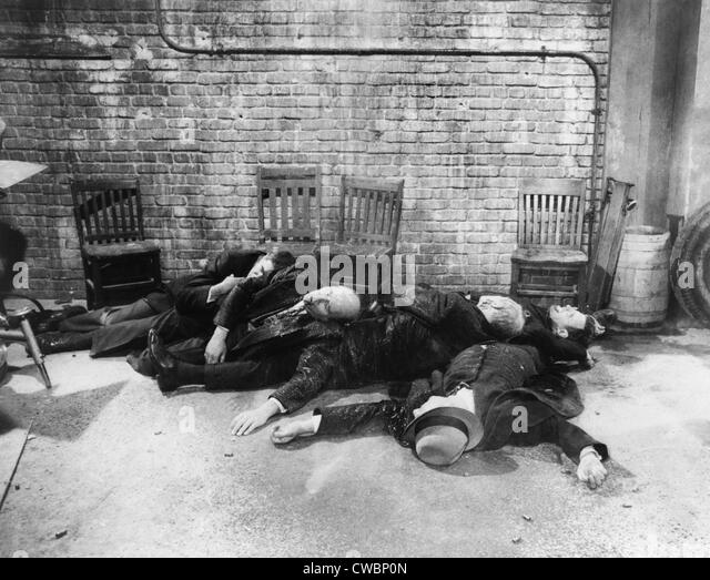 """saint valentines day massacre Posing as police officers conducting a routine raid on february 14, 1929, four men entered a warehouse at 2122 n clark street, used by george """"bugs"""" moran and his gang to store liquor the impostors lined up six gang members and a hanger-on against a wall, produced machine guns from under their overcoats, and."""