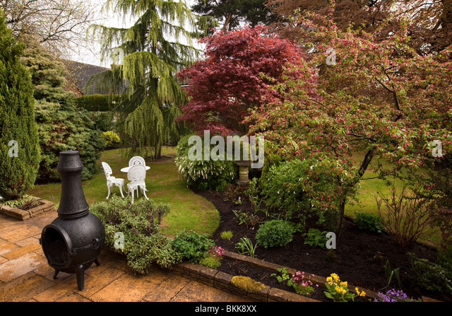 Mesmerizing Low Maintenance Gardens Stock Photos  Low Maintenance Gardens  With Interesting Gardens Domestic Back Garden In Springtime From Patio With Black Chiminea   Stock Image With Astounding Led Lights Garden Also Gardeners World Sutton Coldfield In Addition Greenfield Gardens And Garden Lime Vs Hydrated Lime As Well As Iplayer In The Night Garden Additionally Garden Tool Sharpening Service From Alamycom With   Interesting Low Maintenance Gardens Stock Photos  Low Maintenance Gardens  With Astounding Gardens Domestic Back Garden In Springtime From Patio With Black Chiminea   Stock Image And Mesmerizing Led Lights Garden Also Gardeners World Sutton Coldfield In Addition Greenfield Gardens From Alamycom