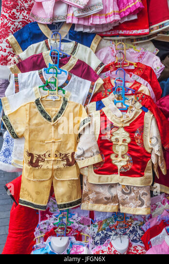 China, Shanghai, Yuyuan Garden, Shop Display of Traditional Childrens' Clothing - Stock Image