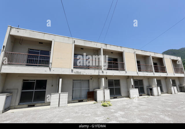 Vacant Old Japanese Apartment Building Against The Blue Sky   Stock Image