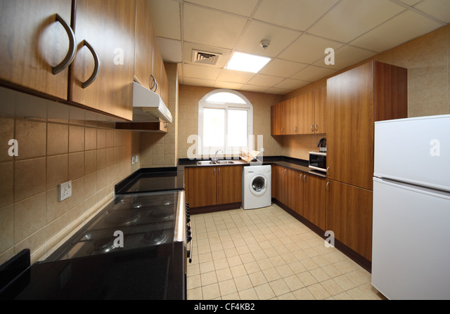Kitchen With Brown Cupboards, Washingmachine, Cooker And Fridge   Stock  Image Part 95
