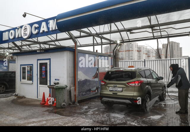Self serve car wash stock photos self serve car wash stock images a man washes his vehicle at a solutioingenieria Choice Image
