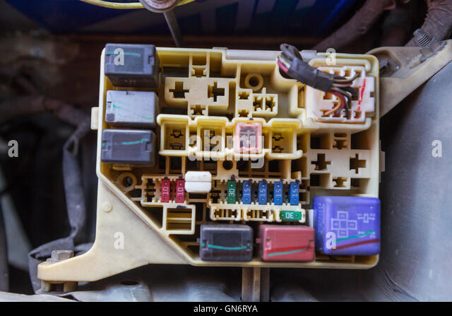 the man opening fuse box of old car gn6rya old fuses fuse box stock photos & old fuses fuse box stock images Car Fuse Box Diagram at bayanpartner.co