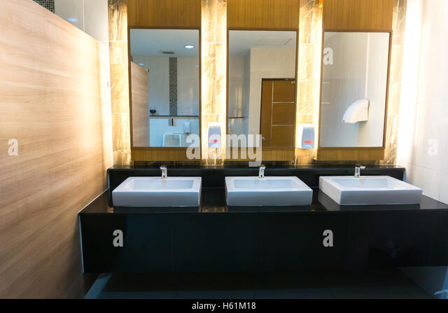 commercial bathroom with three sink and mirror stock image