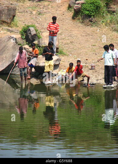 Indians fishing in river stock photos indians fishing in for People catching fish