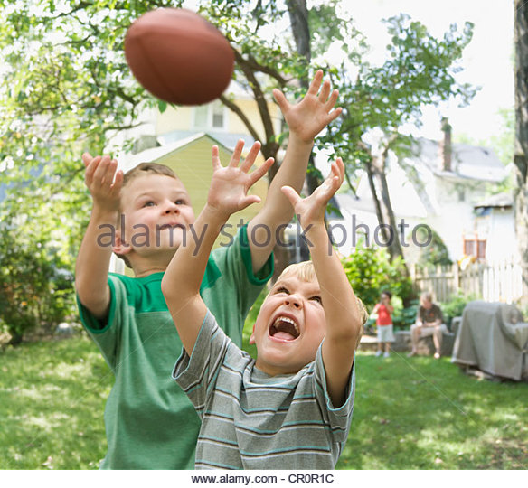 boys playing football stock photos boys playing football stock