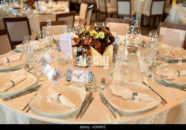 Setup Wedding Table With Plate Fork Knife And Glasses