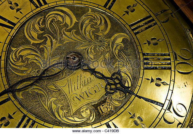 antique grandfather clock face. closeup of antique grandfather clock face stock image