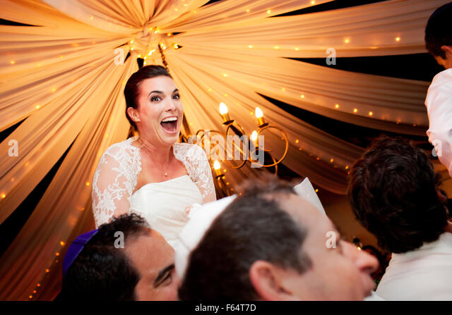 Beautiful Jewish Bride Smiling During The Hora Traditional Dance Wedding