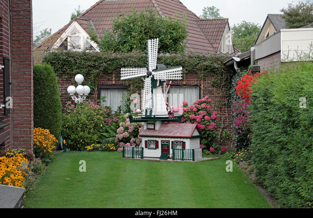 Ornate Garden Ornament In The Shape Of A Windmill In A Garden In Uden, Noord