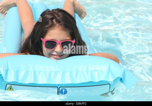 Young Girl On Inflatable Mattress Stock Photos Young Girl On Inflatable Mattress Stock Images