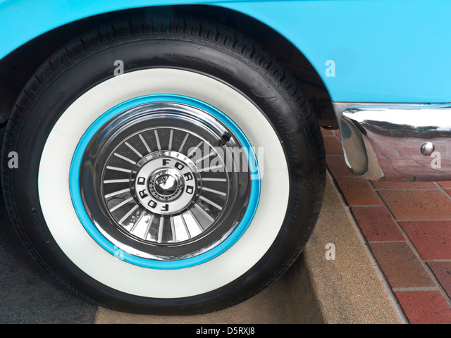 detail on 1950u0027s ford fairlane skyliner american classic motor chrome wheel cap and whitewall tyre